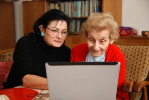Elderly relative and daughter reviewing care homes