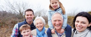 Family with elderly parents being active