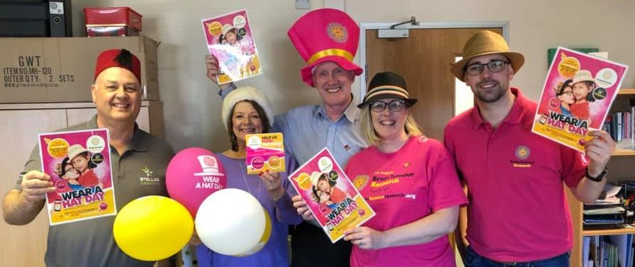 Tim Green of Brain Tumour Reseach Visits Clarity Care Consulting Offices to receive money from Lynn Osborne for Wear A Hat Day 2019